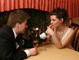 A wedding proposal at a romantic restaurant.