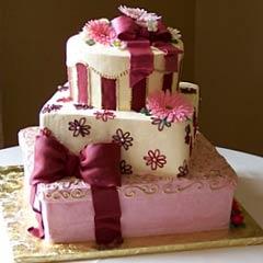 three tier pink, white and burgundy gift box wedding cake