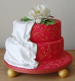 small red two tier wedding cake