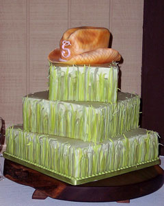 Three tier western style, square green wedding cake with a handmade orange fondant cowboy hat