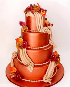 Four tier burnt orange wedding cake