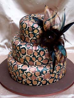 Unique three tier brown and black leopard print wedding cake with rounded edges