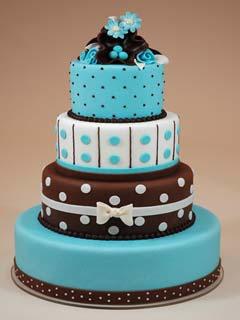 Four tier chocolate brown and blue polka dot fondant wedding cake
