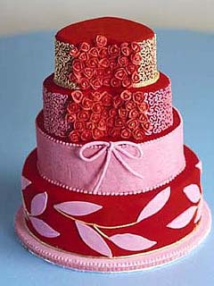 Creative four tier pink and red, red velvet wedding cake