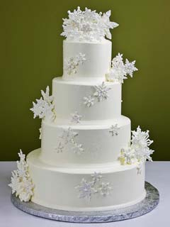 Simple four tier snow white snowflake cake