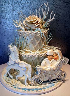 Russian winter theme wedding cake with a horse and carriage. Decorated with fancy fondant criss-cross patterns