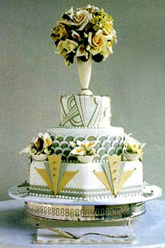 Three tier art deco olive green and white wedding cake decorated with gold and green 1920's style shapes and patterns