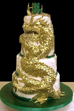 Chinese, four tier white, green and gold dragon cake design, decorated with a huge gold dragon