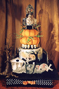 Four tier halloween graveyard cake with a pumpkin cake as the second tier