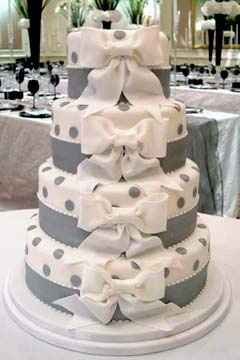 Four tier white and silver wedding cake with silver polka dots