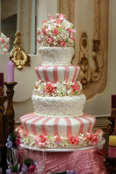 four tier pink and white wedding cake