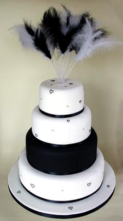 theatrical four tier white and black wedding cake