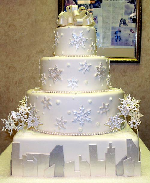 white and silver snowflake four tier wedding cake
