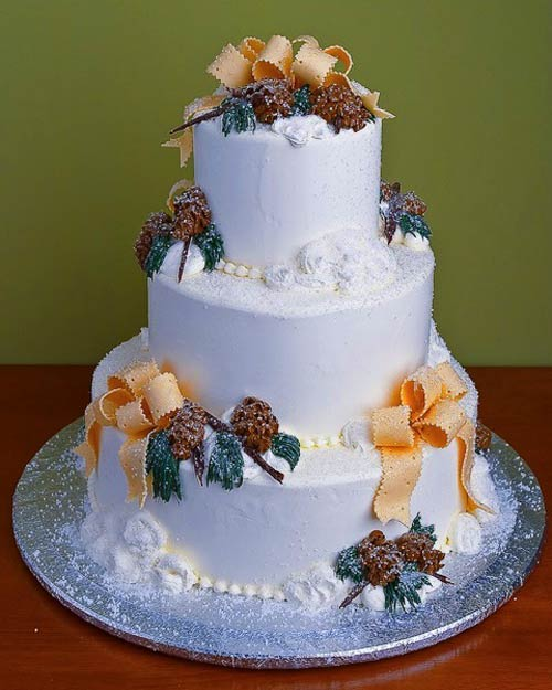 Three tier white snowflake and coconut wedding cake