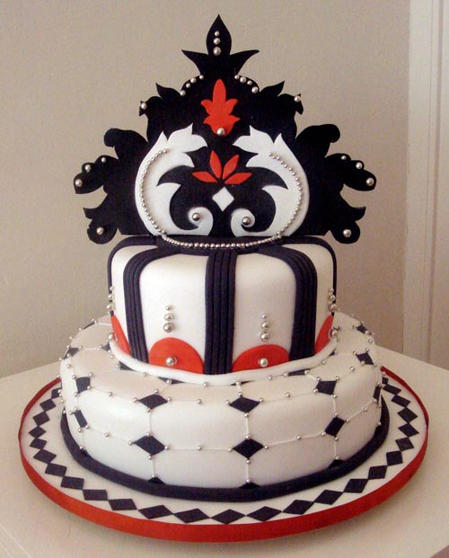 Two tier red, white and black art deco wedding cake