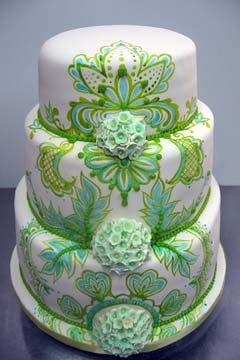 Three tier white and green wedding cake