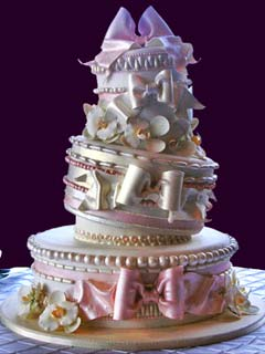 Artistic and creative three tier topsy turvy pink and white wedding cake