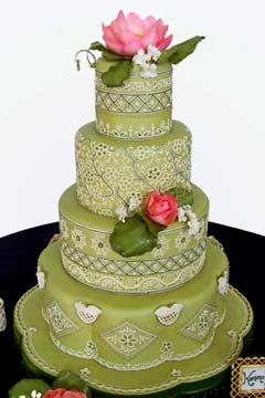 Round shaped, four tier green Indian wedding cake design