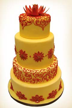 Round shaped orange and red Indian wedding cake