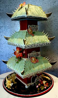 Green Chinese Pagoda three tiered wedding cake, decorated with gumpaste flowers abd a gold dragon