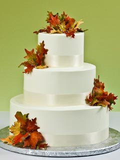 Simple White Three Tier Autumn Leaves Wedding Cake The Are Yellow Orange
