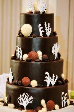 Four tier chocolate wedding cake, decorated with chocolate seashells