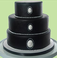Simple three tier silver and black cake, covered with black rolled fondant