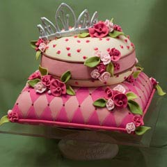 Two tier round and square pink cushion and pillow bridal cake design