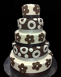 Five tier brown and white funky wedding cake