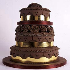 Three tier gold and chocolate wedding cake