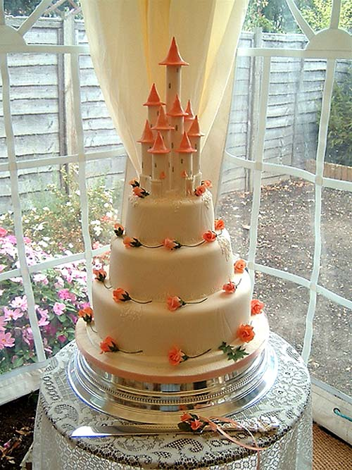 Huge three tier cream and orange wedding cake castle