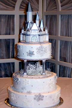 Three tier silver and winter white snowflake princess castle cake