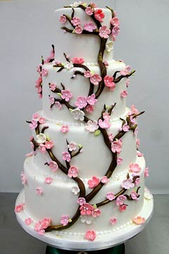 four tier round white cherry blossom wedding cake