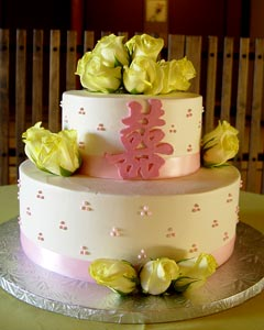 Small two tier, double happiness, pink and white Chinese theme wedding cake