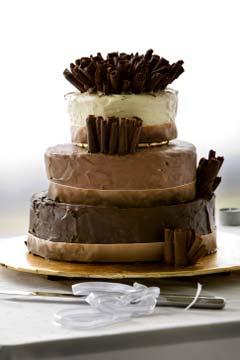 Three tiered chocolate flavoured cake; white, milk and dark chocolate