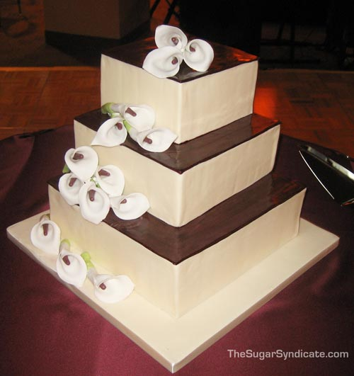 Modern four tier square chocolate wedding cake, beautifully decorated ...