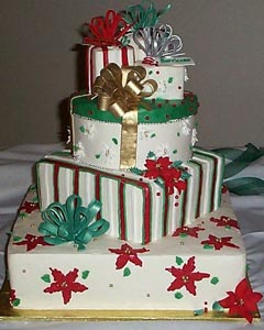 four tier christmas gift box wedding cake decorated with christmas ribbons bows and