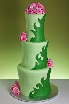 Contemporary tall three tier, two tone green wedding cake with green swirls