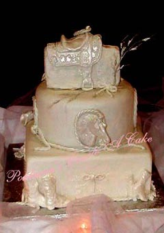 Beige, three tier, round and square, western saddle and cowboy theme wedding cake, decorated with western theme accents