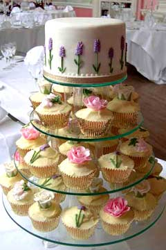 3 tiered yellow, pink and lilac wedding cupcakes.