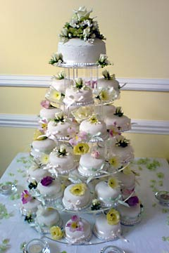 5 tiered miniature wedding cakes  or mini desserts.