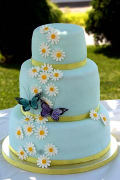 Three Tier Round Light Blue Fondant Wedding Cake Decorated With White Daisy Gum Paste Flowers