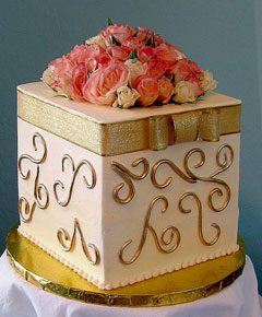 A square wedding cake made to look like a gift box cake