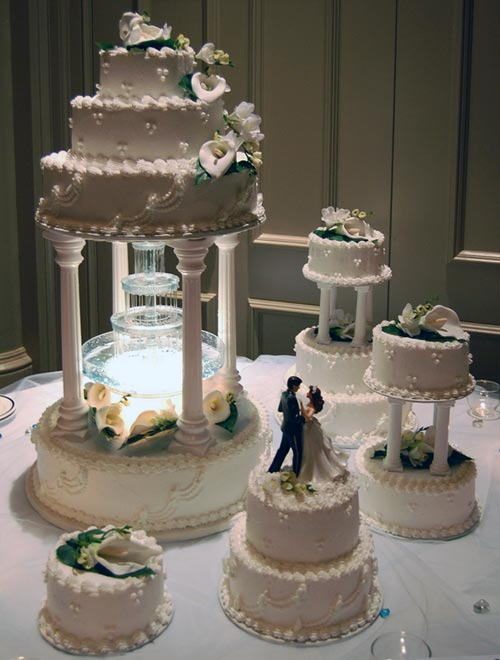 Four tier water fountain butter cream wedding cake