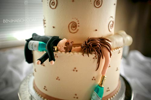 Funny two tier wedding cake with a drunk bride and groom funny cake topper