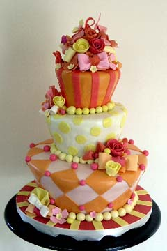 Three tier topsy turvy orange, red, yellow and pink fun cake design