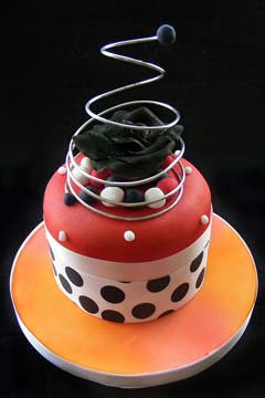 Red, white, orange and black polka dot groovy cake design 1960's inspired wedding cake