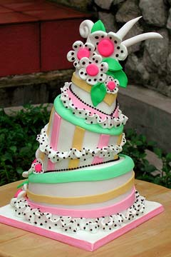 Quirky topsy turvy three tier wedding cake