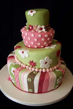 Four tier pink and green topsy turvy wedding cake