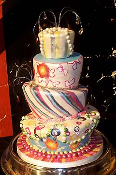 Psychedelic four tier wedding cake 1970's  inspired topsy turvy cake